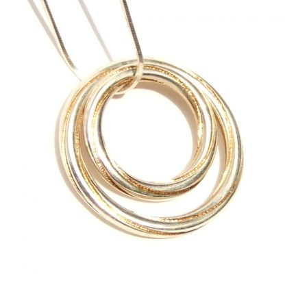 Silver and gold double pendant