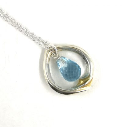 Silver and gold Topaz pendant