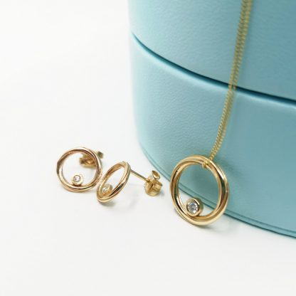 diamond and gold necklace and earring set
