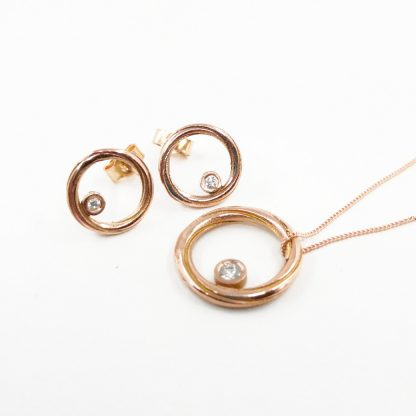diamond and rose gold necklace and earring set